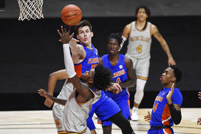 Boston College's CJ Felder shoots as Florida's Colin Castleton, top, defends during the first half of an NCAA college basketball game Thursday, Dec. 3, 2020, in Uncasville, Conn. (AP Photo/Jessica Hill)