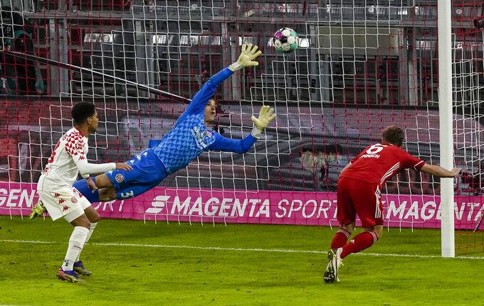 Bayern Munich's Joshua Kimmich, right, scores during the German first division Bundesliga football match between FC Bayern Munich and Mainz 05 in Munich, Germany, Sunday Jan. 3, 2021. (Guenter Schiffmann/Pool via AP)