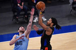 New York Knicks guard Derrick Rose (4) goes to the basket past Memphis Grizzlies guard John Konchar (46) during the first half of an NBA basketball game Friday, April 9, 2021, at Madison Square Garden in New York. (AP Photo/Mary Altaffer, Pool)