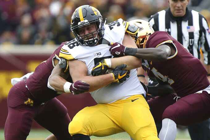 Iowa's Mitch Riggs is tackled by Minnesota's defensive back Terell Smith during an NCAA college football game Saturday, Oct. 6, 2018, in Minneapolis. (AP Photo/Stacy Bengs)