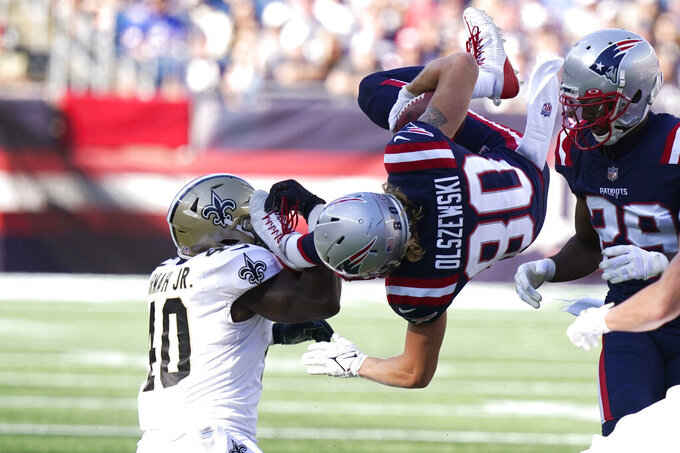New England Patriots wide receiver Gunner Olszewski (80) is upended by New Orleans Saints running back Alex Armah (40) during the second half of an NFL football game, Sunday, Sept. 26, 2021, in Foxborough, Mass. (AP Photo/Steven Senne)