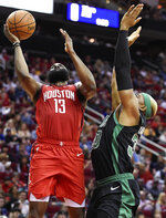 Houston Rockets guard James Harden (13) drives to the basket as Boston Celtics forward Guerschon Yabusele defends during the first half of an NBA basketball game, Thursday, Dec. 27, 2018, in Houston. (AP Photo/Eric Christian Smith)