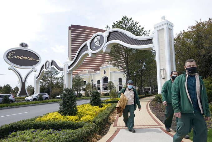 Workers depart a main gate to the Encore Boston Harbor casino, Wednesday, April 28, 2021, in Everett, Mass. The Encore Boston Harbor casino began offering COVID-19 vaccinations on Tuesday, April 27, by appointment only to employees and the general public in conjunction with Cambridge Health Alliance, a local health care organization. (AP Photo/Steven Senne)