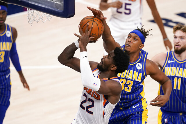 Phoenix Suns' Deandre Ayton (22) shoots against Indiana Pacers' Myles Turner (33) during the first half of an NBA basketball game, Saturday, Jan. 9, 2021, in Indianapolis. (AP Photo/Darron Cummings)