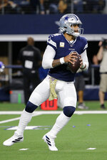 Dallas Cowboys quarterback Dak Prescott drops back to pass during the second half of the team's NFL football game against the Minnesota Vikings in Arlington, Texas, Sunday, Nov. 10, 2019. (AP Photo/Michael Ainsworth)