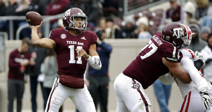 Texas A&M quarterback Kellen Mond (11) throws a pass against Mississippi during the second half of an NCAA college football game Saturday, Nov. 10, 2018, in College Station, Texas. Texas A&M won 38-24. (AP Photo/David J. Phillip)