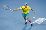Alex de Minaur of Australia plays a shot against Rafael Nadal of Spain during their ATP Cup tennis match in Sydney, Saturday, Jan. 11, 2020. (AP Photo/Steve Christo)