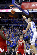 Creighton's Christian Bishop (13) dunks against Nebraska's Kevin Cross, left, and Matej Kavas (25) during the first half of an NCAA college basketball game in Omaha, Neb., Saturday, Dec. 7, 2019. (AP Photo/Nati Harnik)