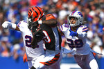 Buffalo Bills' Kevin Johnson (29) tackles Cincinnati Bengals' Auden Tate (19) during the first half of an NFL football game Sunday, Sept. 22, 2019, in Orchard Park, N.Y. (AP Photo/Adrian Kraus)