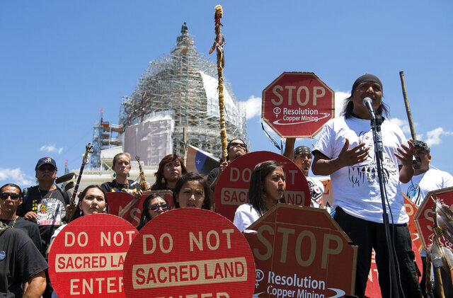FILE - In this July 22, 2015, file photo, Tribal councilman Wendsler Nosie, Sr. speaks with Apache activists in a rally to save Oak Flat, land near Superior, Ariz., sacred to Western Apache tribes, in front of the U.S. Capitol in Washington. A group of Apaches who have tried for years to reverse a land swap in Arizona that will make way for one of the largest and deepest copper mines in the U.S. sued the federal government Tuesday, Jan. 12, 2021. Apache Stronghold argues in the lawsuit filed in U.S. District Court in Arizona that the U.S. Forest Service cannot legally transfer land to international mining company Rio Tinto in exchange for eight parcels the company owns around Arizona. (AP Photo/Molly Riley, File)