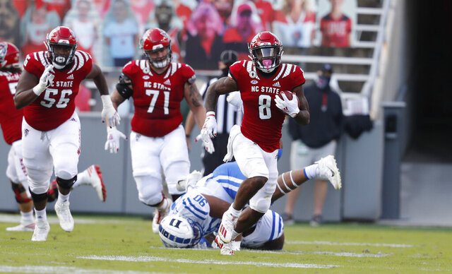 North Carolina State running back Ricky Person Jr. (8) runs against Duke during the first half of an NCAA college football game at Carter-Finley Stadium in Raleigh, N.C., Saturday, Oct. 17, 2020. (Ethan Hyman/The News & Observer via AP)