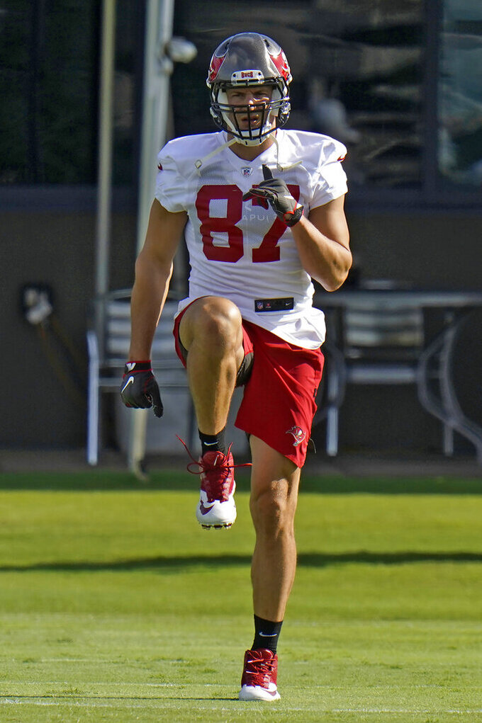 Tampa Bay Buccaneers tight end Rob Gronkowski (87) stretches during an NFL football minicamp Tuesday, June 8, 2021, in Tampa, Fla. (AP Photo/Chris O'Meara)