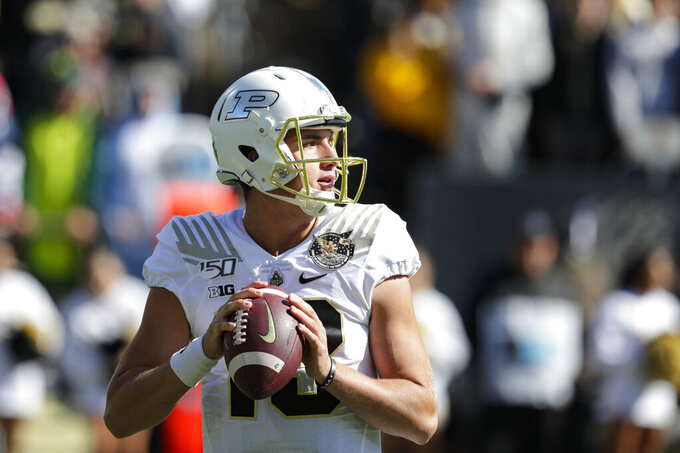 Purdue quarterback Jack Plummer (13) throws against Maryland during the first half of an NCAA college football game in West Lafayette, Ind., Saturday, Oct. 12, 2019. (AP Photo/Michael Conroy)