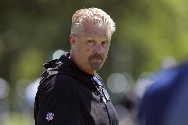 FILE - In this June 4, 2019, file photo, New York Jets defensive coordinator Gregg Williams looks on as his players run drills at the team's NFL football training facility in Florham Park, N.J. A person with direct knowledge of the decision says the New York Jets fired defensive coordinator Gregg Williams a day after his stunning play call cost the team its first win of the season. The still-winless Jets were seconds away from their first victory Sunday, Dec. 6, 2020, until Williams inexplicably called for an all-out blitz against Las Vegas. (AP Photo/Julio Cortez, File)