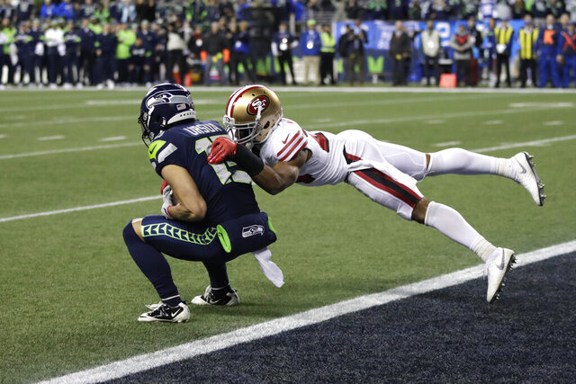 Seattle Seahawks' John Ursua, left, makes a catch at the one-yard line to give the team a first down with less than a minute left as San Francisco 49ers' K'Waun Williams tackles during the second half of an NFL football game, Sunday, Dec. 29, 2019, in Seattle. The 49ers won 26-21. (AP Photo/Stephen Brashear)