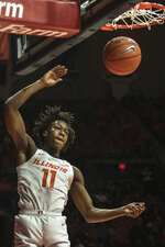 Illinois' Ayo Dosunmu (11) dunks against Nebraska in the first half of an NCAA college basketball game Monday, Feb. 24, 2020, in Champaign, Ill. (AP Photo/Holly Hart)