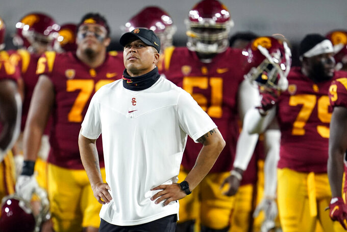 Southern California head coach Donte Williams stands on the field before an NCAA college football game against Oregon State Saturday, Sept. 25, 2021, in Los Angeles. (AP Photo/Marcio Jose Sanchez)
