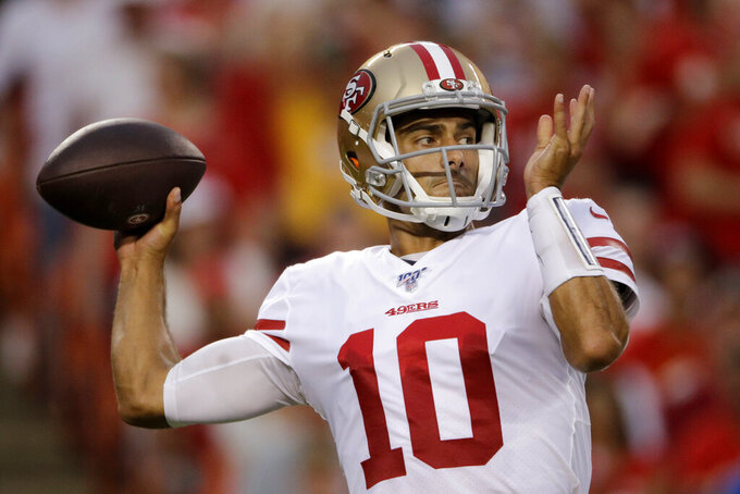 FILE - In this Aug. 24, 2019, file photo, San Francisco 49ers quarterback Jimmy Garoppolo (10) throws a pass during the first half of an NFL preseason football game against the Kansas City Chiefs, in Kansas City, Mo. After an up-and-down preseason in his recovery from ACL surgery, San Francisco 49ers quarterback Jimmy Garoppolo prepares for his first real game in nearly a year. (AP Photo/Charlie Riedel, File)