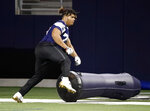 Dallas Cowboys rookie defensive tackle Trysten Hill runs through a drill during the NFL football team's minicamp in Frisco, Texas, Friday, May 10, 2019. (AP Photo/Tony Gutierrez)