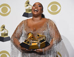 "Lizzo poses in the press room with the awards for best pop solo performance for ""Truth Hurts"", best urban contemporary album for ""Cuz I Love You"" and best traditional R&B performance for ""Jerome"" at the 62nd annual Grammy Awards at the Staples Center on Sunday, Jan. 26, 2020, in Los Angeles. (AP Photo/Chris Pizzello)"