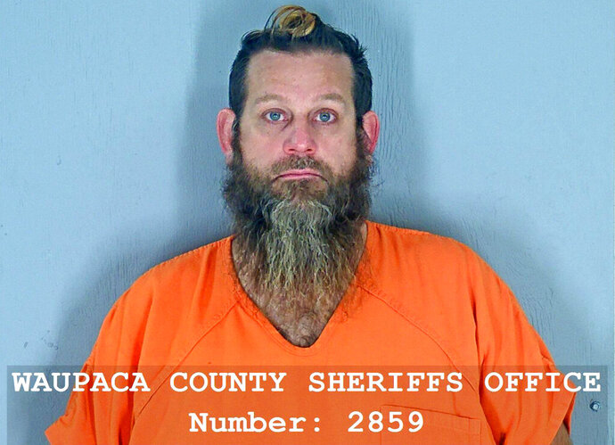 This booking photo released by the Waupaca County, Wis., Sheriff's Office, shows Bill Zelenski, accused of killing a young man in a dispute over stolen reptiles and has been charged with first-degree intentional homicide. Zelenski, 44, of Waupaca, is accused of shooting the 18-year-old late Monday, Oct. 19, 2020. The victim's name was not immediately released, but the victim's mother, Tiffany Powell, 34, was charged with first degree intentional homicide as party to a crime. (Waupaca County Sheriff's Office via AP)