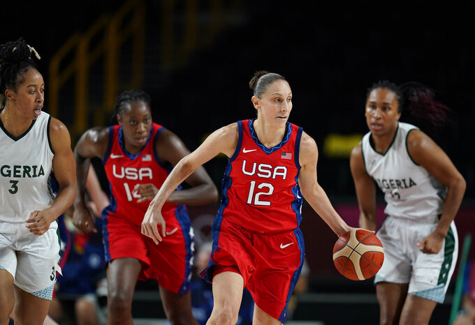 United States' Diana Taurasi (12) drives up the court during women's basketball preliminary round game at the 2020 Summer Olympics, Tuesday, July 27, 2021, in Saitama, Japan. (AP Photo/Charlie Neibergall)