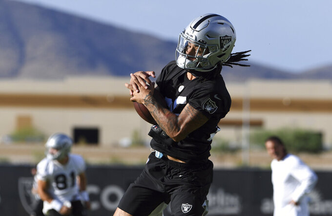 Las Vegas Raiders safety Tre'von Moehrig makes a catch during an NFL football practice Saturday, July 31, 2021, in Henderson, Nev. (AP Photo/David Becker)