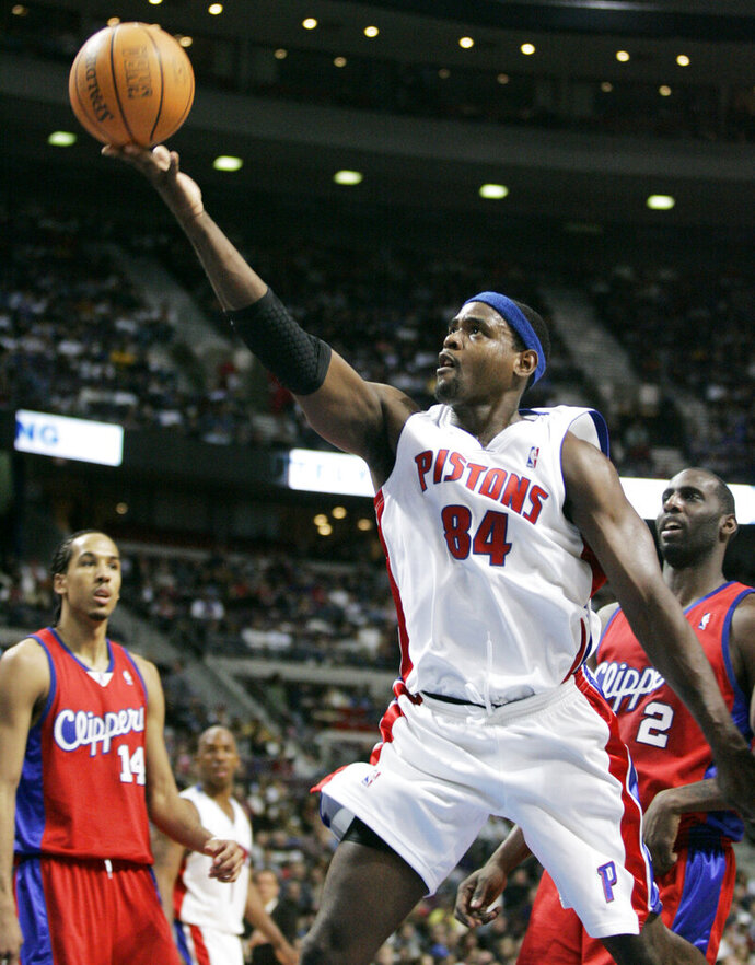 FILE- In this Feb. 12, 2007, file photo, Detroit Pistons center Chris Webber (84) shoots in front of Los Angeles Clippers forward Tim Thomas (2) and guard Shaun Livingston (14) during the second half of an NBA basketball game in Auburn Hills, Mich. Webber is among 13 finalists for enshrinement later this year into the Basketball Hall of Fame. (AP Photo/Duane Burleson, File)
