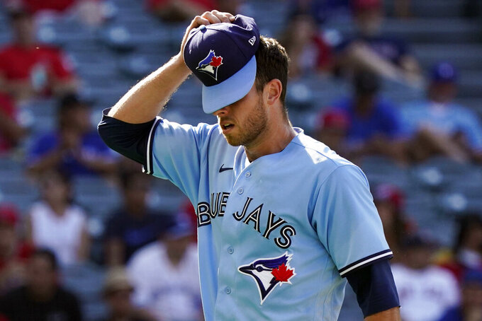 Toronto Blue Jays starting pitcher Steven Matz adjusts his cap as he is replaced during the fifth inning in the first baseball game of the team's doubleheader against the Los Angeles Angels on Tuesday, Aug. 10, 2021, in Anaheim, Calif. (AP Photo/Marcio Jose Sanchez)