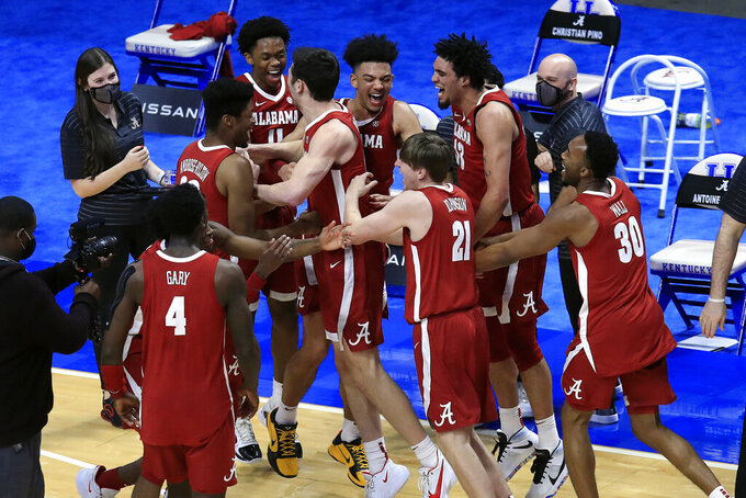Alabama players celebrate after defeating Kentucky 85-65 in an NCAA college basketball game in Lexington, Ky., Tuesday, Jan. 12, 2021.  (AP Photo/James Crisp)