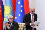 Representative of the EU for Foreign Affairs and Security Policy, Josep Borrell, left, applauds as Afghanistan's President Ashraf Ghani, walks past during the Central and South Asia 2021 conference in Tashkent, Uzbekistan, Friday, July 16, 2021. (AP Photo)