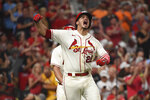 St. Louis Cardinals' Nolan Arenado reacts after hitting a two-run home run during the eighth inning of a baseball game against the Cincinnati Reds on Saturday, Sept. 11, 2021, in St. Louis. (AP Photo/Joe Puetz)