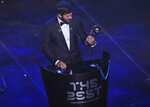 Brazilian Liverpool goalkeeper Alisson Becker receives Best FIFA goalkeeper award during the ceremony of the Best FIFA Football Awards, in Milan's La Scala theater, northern Italy, Monday, Sept. 23, 2019. . (AP Photo/Antonio Calanni)