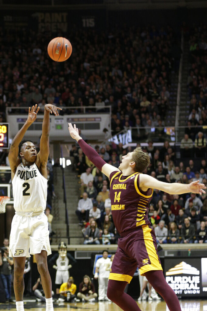 Purdue guard Eric Hunter Jr. (2) shoots over Central Michigan forward David DiLeo (14) during the first half of an NCAA college basketball game in West Lafayette, Ind., Saturday, Dec. 28, 2019. (Nikos Frazier/Journal & Courier via AP)