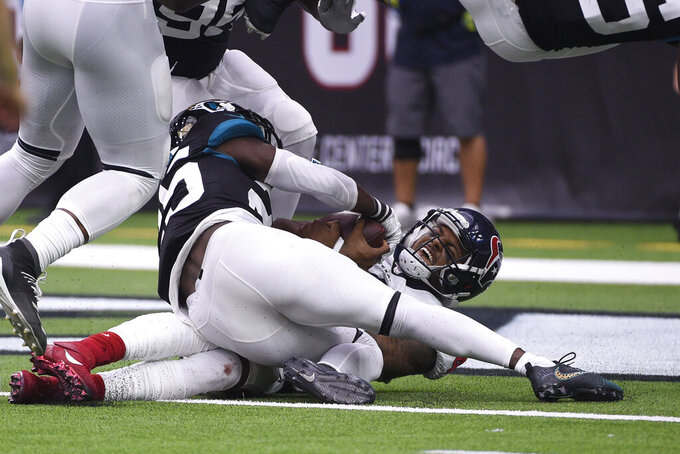 Houston Texans quarterback Deshaun Watson (4) is hit by Jacksonville Jaguars defensive back D.J. Hayden (25) as he falls into the end zone for a touchdown during the second half of an NFL football game Sunday, Sept. 15, 2019, in Houston. (AP Photo/Eric Christian Smith)