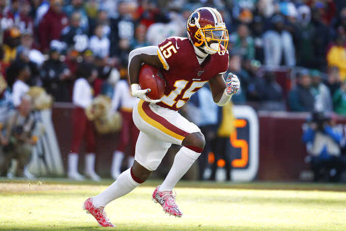 Washington Redskins wide receiver Steven Sims (15) runs with the ball against the Philadelphia Eagles in the first half of an NFL football game, Sunday, Dec. 15, 2019, in Landover, Md. (AP Photo/Alex Brandon)