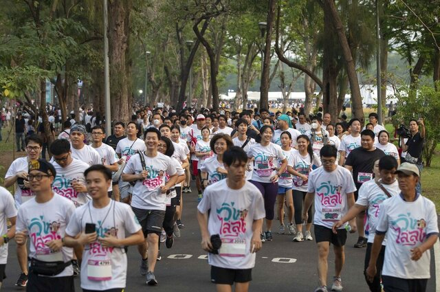 Supporters of the anti-military Future Forward Party participate in a run dubbed as
