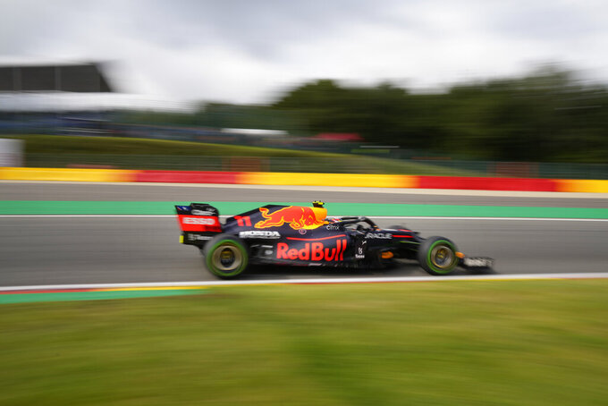 Red Bull driver Sergio Perez of Mexico steers his car during the first practice session prior to the Formula One Grand Prix at the Spa-Francorchamps racetrack in Spa, Belgium, Friday, Aug. 27, 2021. The Belgian Formula One Grand Prix will take place on Sunday. (AP Photo/Francisco Seco)