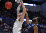 Purdue's Matt Haarms, left, is fouled as he goes to the hoop by Old Dominion's Elbert Robinson III (25) during the first half of a first round men's college basketball game in the NCAA Tournament, Thursday, March 21, 2019, in Hartford, Conn. (AP Photo/Elise Amendola)