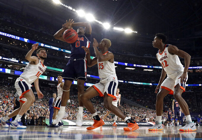 Auburn's Horace Spencer (0) battles for a loose ball against Virginia's Ty Jerome (11) and Mamadi Diakite (25) during the first half in the semifinals of the Final Four NCAA college basketball tournament, Saturday, April 6, 2019, in Minneapolis. (AP Photo/David J. Phillip)