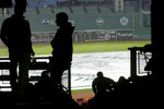 People wait in the stands during a rain delay at Fenway Park before a scheduled baseball game between the Oakland Athletics and the Boston Red Sox, Tuesday, May 15, 2018, in Boston. (AP Photo/Steven Senne)