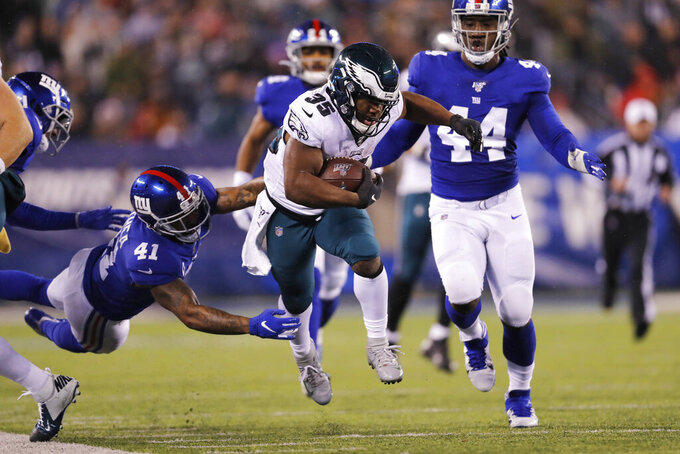 Philadelphia Eagles running back Boston Scott (35) runs with the ball past New York Giants free safety Antoine Bethea (41) in the first half of an NFL football game, Sunday, Dec. 29, 2019, in East Rutherford, N.J. (AP Photo/Adam Hunger)