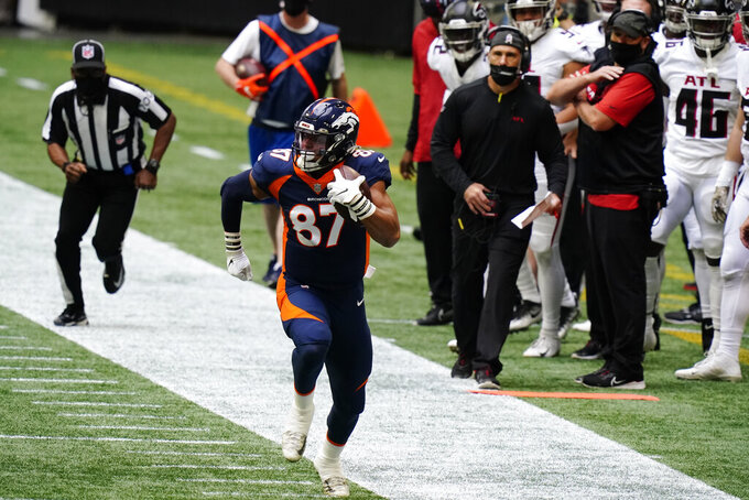 Denver Broncos tight end Noah Fant (87) runs up the sideline during the first half of an NFL football game against the Atlanta Falcons, Sunday, Nov. 8, 2020, in Atlanta. (AP Photo/Brynn Anderson)