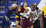 Minnesota wide receiver Rashod Bateman (13) is pushed out of bounds by Georgia Tech defensive back Tre Swilling (3) during the first half of the Quick Lane Bowl NCAA college football game Wednesday, Dec. 26, 2018, in Detroit. (AP Photo/Carlos Osorio)