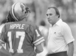 Detroit Lions coach Darryl Rogers, right, talks to quarterback Eric Hipple during an NFL football game, date not known. Rogers, who coached Michigan State to a share of the Big Ten title in 1978 and later took the helm for the Lions, has died. He was 83. The Lions said Rogers' family confirmed his death Wednesday, July 11, 2018. (Detroit News via AP)