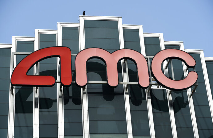 FILE - In this April 29, 2020 file photo, the AMC sign appears at AMC Burbank 16 movie theater complex in Burbank, Calif. AMC Theaters, the nation's largest chain, is pushing back its plans to begin reopening theaters by two weeks. The company said Monday that it would open approximately 450 U.S. locations on July 30 and the remaining 150 the following week. (AP Photo/Chris Pizzello, File)