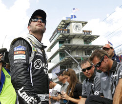 FILE - Sprint Cup Series driver Jimmie Johnson looks up at the scoring pylon during qualifications for the Brickyard 400 auto race at the Indianapolis Motor Speedway in Indianapolis, in this Saturday, July 27, 2013, file photo. Jimmie Johnson makes his debut on the Indianapolis Motor Speedway road course this weekend in his third start in the IndyCar Series. (AP Photo/AJ Mast, File)