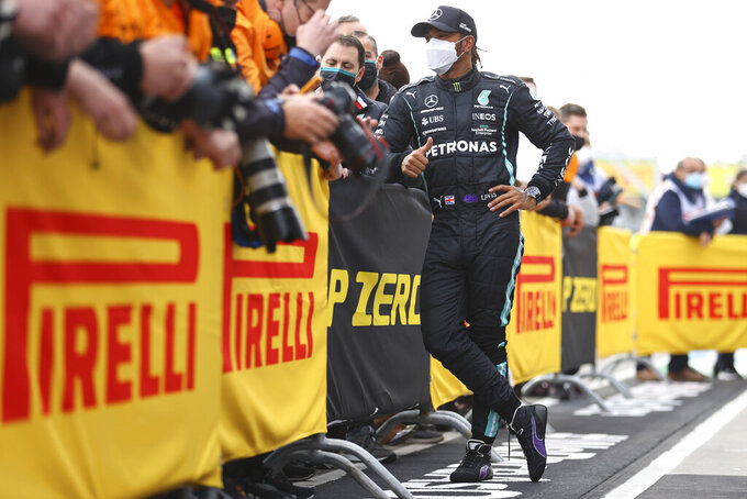 Second placed Mercedes Lewis Hamilton celebrates with teammates at the end of the Emilia Romagna Formula One Grand Prix, at the Imola racetrack, Italy, Sunday, April 18, 2021. (Bryn Lennon/ Pool Via AP)