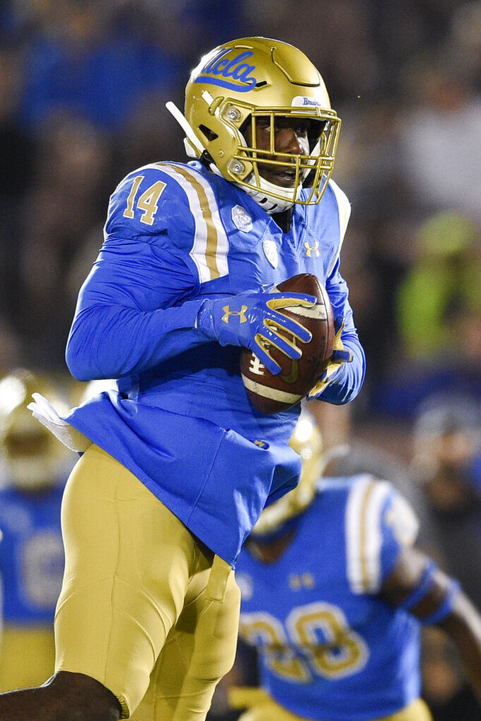 UCLA linebacker Krys Barnes intercepts a pass by Colorado quarterback Steven Montez during the first half of an NCAA college football game in Los Angeles, Saturday, Nov. 2, 2019. (AP Photo/Kelvin Kuo)