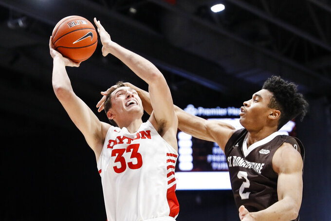 Dayton's Ryan Mikesell (33) shoots against St. Bonaventure's Robert Carpenter (2) during the first half of an NCAA college basketball game, Wednesday, Jan. 22, 2020, in Dayton, Ohio. (AP Photo/John Minchillo)